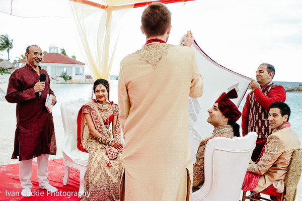 Indian bride and groom during their wedding ceremony. in Playa del Carmen Playa del Carmen Destination Indian Wedding by Ivan Luckie Photography