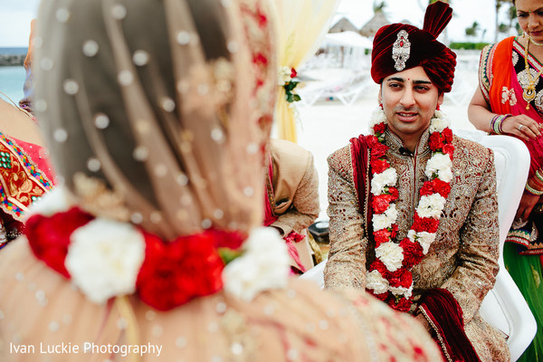 Indian groom at his wedding ceremony. in Playa del Carmen Playa del Carmen Destination Indian Wedding by Ivan Luckie Photography