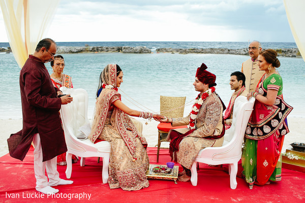 Indian bride and groom at their wedding ceremony. in Playa del Carmen Playa del Carmen Destination Indian Wedding by Ivan Luckie Photography