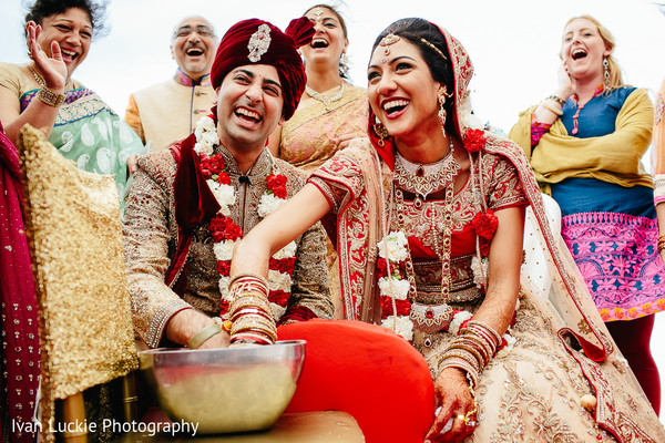 Indian bride and groom smiling during wedding ceremony. in Playa del Carmen Playa del Carmen Destination Indian Wedding by Ivan Luckie Photography