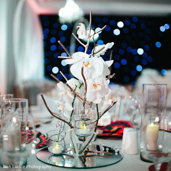 Orchids reception centerpieces in Playa del Carmen Playa del Carmen Destination Indian Wedding by Ivan Luckie Photography