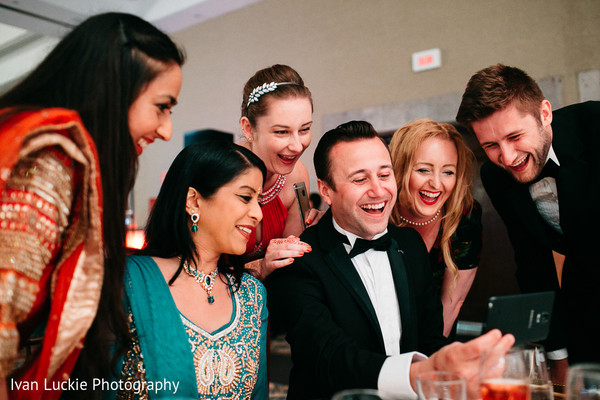Guests having fun at indian wedding reception. in Playa del Carmen Playa del Carmen Destination Indian Wedding by Ivan Luckie Photography