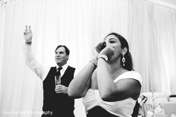 Guests at the wedding reception. in Playa del Carmen Playa del Carmen Destination Indian Wedding by Ivan Luckie Photography