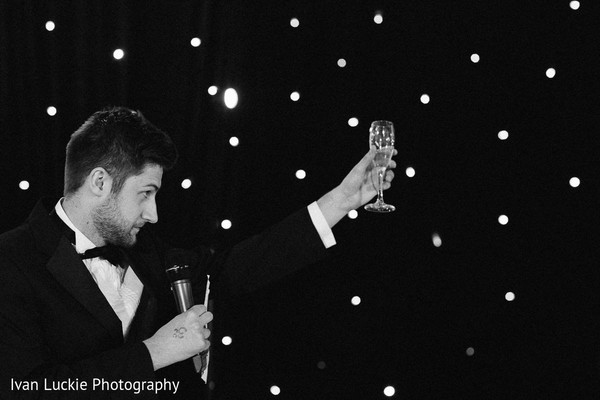 A toast in honor of the indian bride and groom. in Playa del Carmen Playa del Carmen Destination Indian Wedding by Ivan Luckie Photography