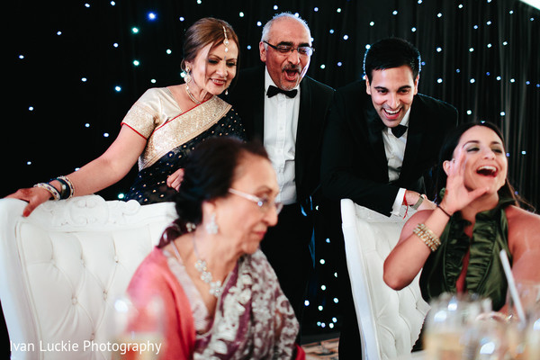 Family and friends enjoing Indian wedding reception in Playa del Carmen Playa del Carmen Destination Indian Wedding by Ivan Luckie Photography
