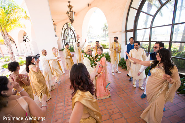 Indian Groomsmen and bridesmaids having fun with the couple in Santa Barbara, CA Indian Wedding by ProImage Weddings