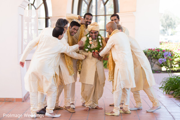 Indian Groomsmen having fun with the groom in Santa Barbara, CA Indian Wedding by ProImage Weddings
