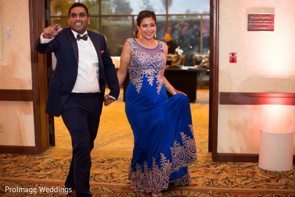 Lovely Indian couple making an entrance to their wedding reception in Santa Barbara, CA Indian Wedding by ProImage Weddings