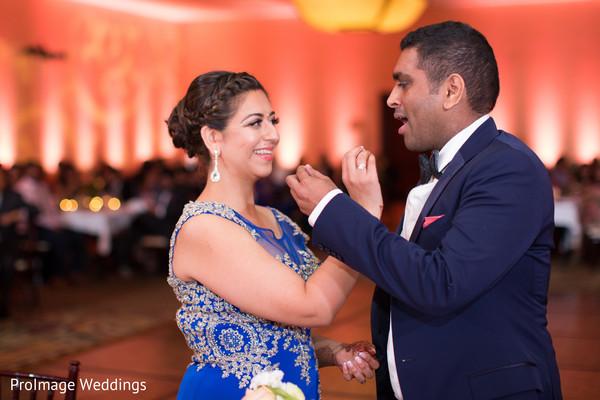 Beautiful indian couple cutting their wedding cake in Santa Barbara, CA Indian Wedding by ProImage Weddings
