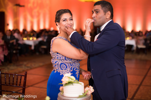 Beautiful indian couple cutting their wedding cake in Santa Barbara, CA Indian Wedding by ProImage Weddings
