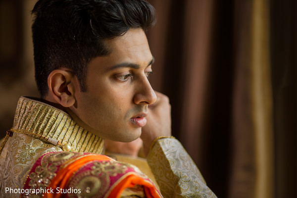 Handsome indian groom getting ready. in Alexandria, VA Indian Wedding by Photographick Studios