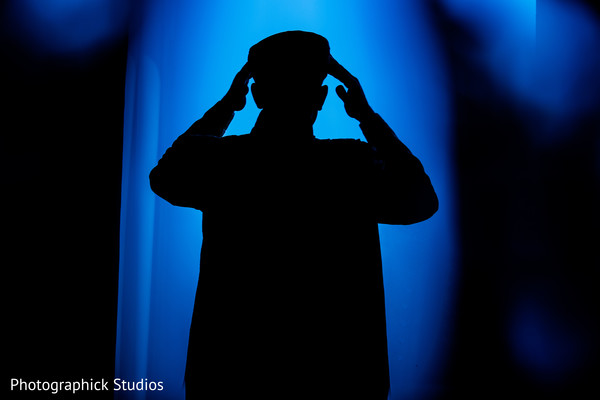 Black and blue Silhouette of indian groom getting ready. in Alexandria, VA Indian Wedding by Photographick Studios