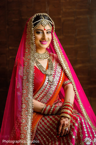 Stunning portrait of indian bride in her wedding ceremony outfit. in Alexandria, VA Indian Wedding by Photographick Studios