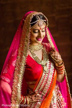 indian bride portrait,indian bridal outfit,indian bridal jewelry,indian bride hair and make up