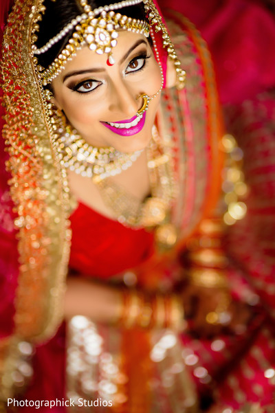 See the perfect make up of this lovely indian bride. in Alexandria, VA Indian Wedding by Photographick Studios