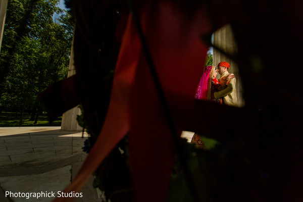 Smalls view of indian bride and groom. in Alexandria, VA Indian Wedding by Photographick Studios