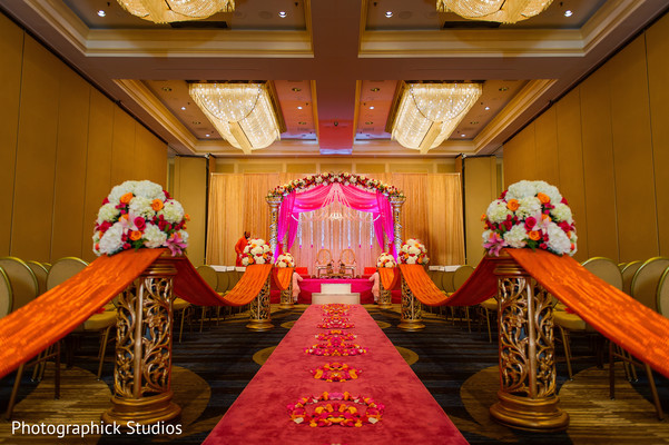 View of indian wedding ceremony floral and decor. in Alexandria, VA Indian Wedding by Photographick Studios
