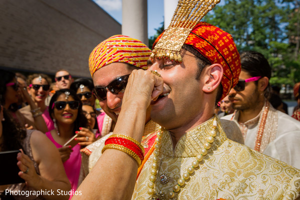 Baraat arriving and received by the bride's mother. in Alexandria, VA Indian Wedding by Photographick Studios
