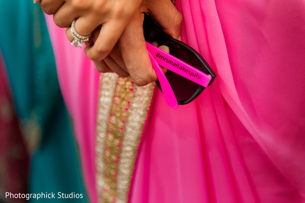 Personalized sun glasses with bride and groom's hashtag. in Alexandria, VA Indian Wedding by Photographick Studios