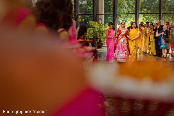 Indian bride walking towards her wedding ceremony. in Alexandria, VA Indian Wedding by Photographick Studios