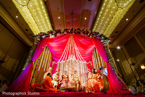 Amazing red draped madap. in Alexandria, VA Indian Wedding by Photographick Studios