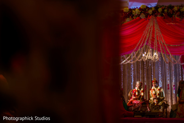 Long view of indian bride and groom in their wedding ceremony.