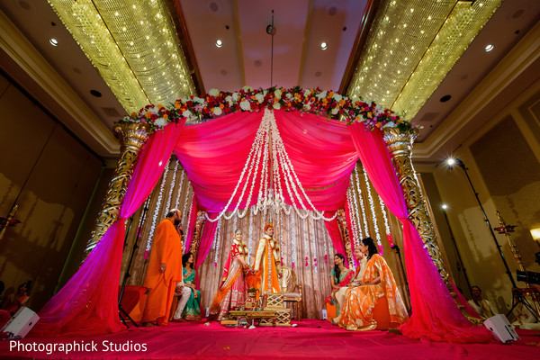 Lovely Indian bride and groom at their wedding ceremony. in Alexandria, VA Indian Wedding by Photographick Studios