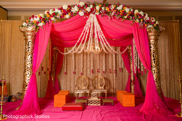 Beautiful hot pink and flowered mandap.