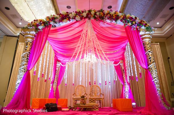 Beautiful hot pink glowing mandap. in Alexandria, VA Indian Wedding by Photographick Studios