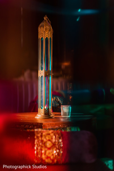 Golden centerpiece  lamp. in Alexandria, VA Indian Wedding by Photographick Studios