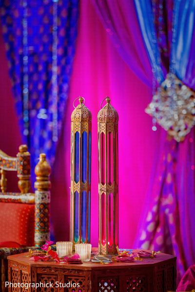 Blue and hot pink as original centerpieces. in Alexandria, VA Indian Wedding by Photographick Studios