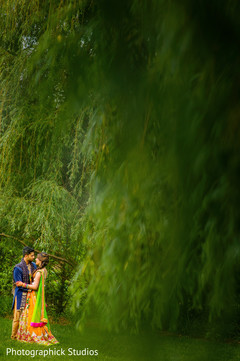 Green setting for indian bride and groom portrait.
