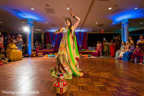 See this beautiful bride dancing  for all her guests. in Alexandria, VA Indian Wedding by Photographick Studios