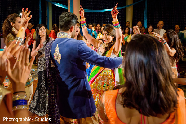 Joyful bride and groom dancing. in Alexandria, VA Indian Wedding by Photographick Studios