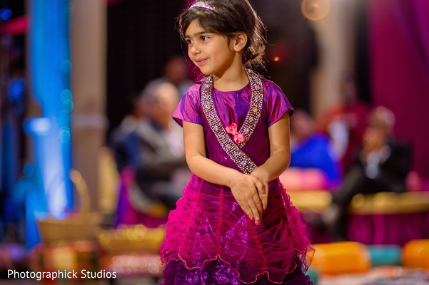 Little indian girl in a purple dress. in Alexandria, VA Indian Wedding by Photographick Studios
