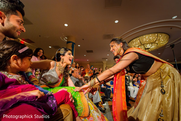 Colorful indian bride during a pre-wedding celebration. in Alexandria, VA Indian Wedding by Photographick Studios
