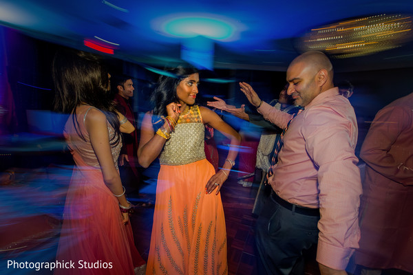 Guests dancing and celebrating. in Alexandria, VA Indian Wedding by Photographick Studios