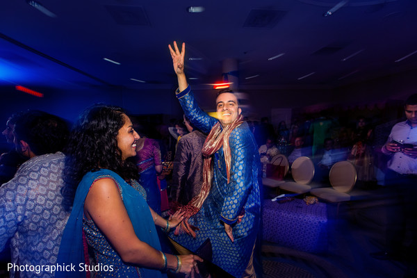 Guests enjoying at an indian wedding pre-celebration night. in Alexandria, VA Indian Wedding by Photographick Studios