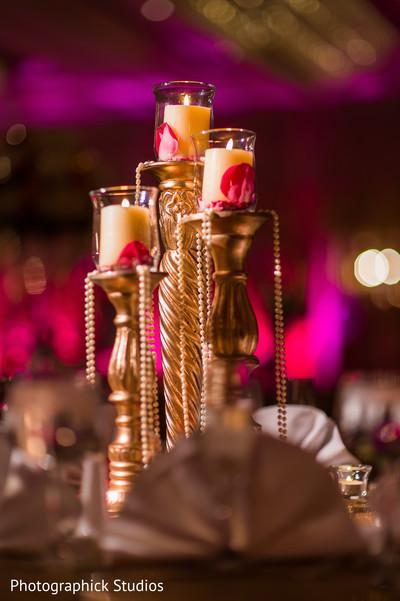 Golden centerpiece decorations. in Alexandria, VA Indian Wedding by Photographick Studios