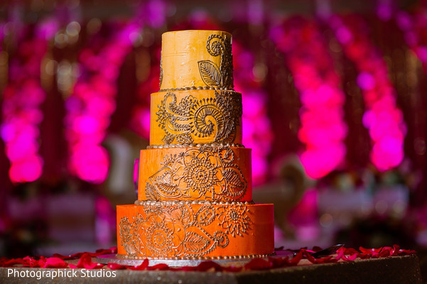 Orange and yellow Indian wedding cake design. in Alexandria, VA Indian Wedding by Photographick Studios
