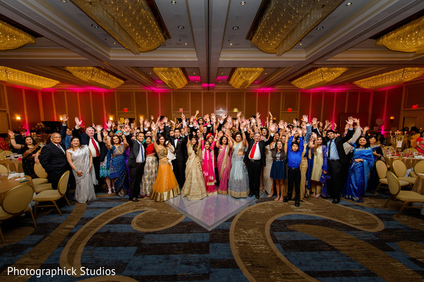 Beautiful memory of all guests celebrating. in Alexandria, VA Indian Wedding by Photographick Studios