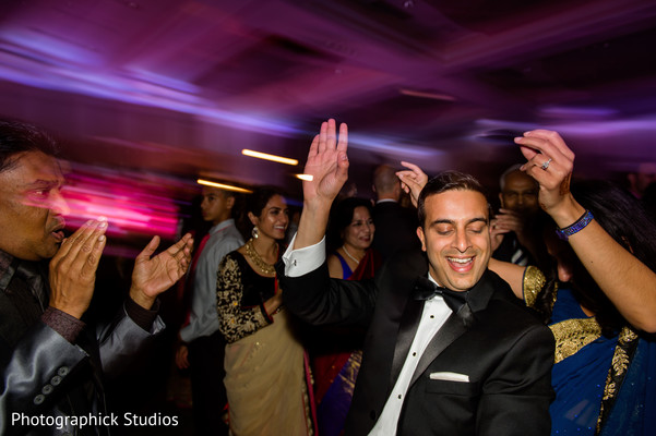 Indian groom dancing. in Alexandria, VA Indian Wedding by Photographick Studios