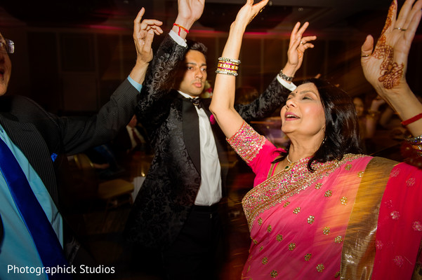 Indian groom dancing during his wedding reception in Alexandria, VA Indian Wedding by Photographick Studios