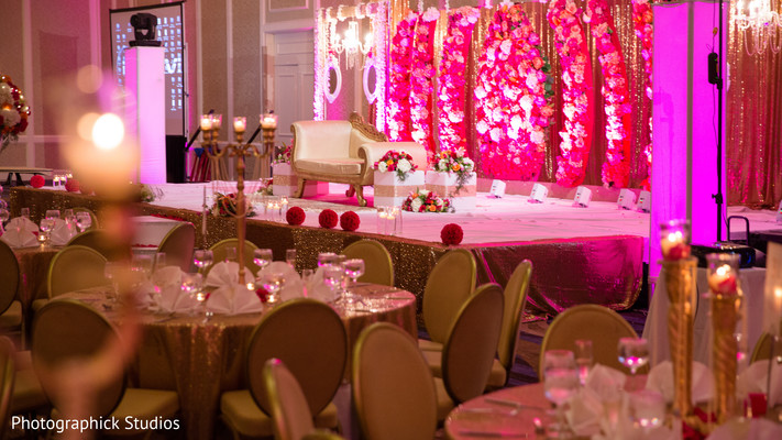 Flowered indian wedding reception stage. in Alexandria, VA Indian Wedding by Photographick Studios