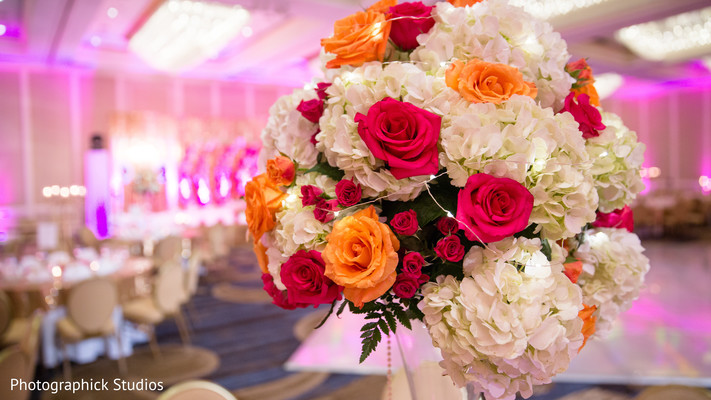 Indian wedding reception flower centerpiece. in Alexandria, VA Indian Wedding by Photographick Studios