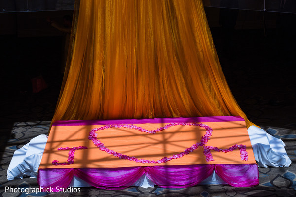 Indian wedding organge draping stage in Alexandria, VA Indian Wedding by Photographick Studios