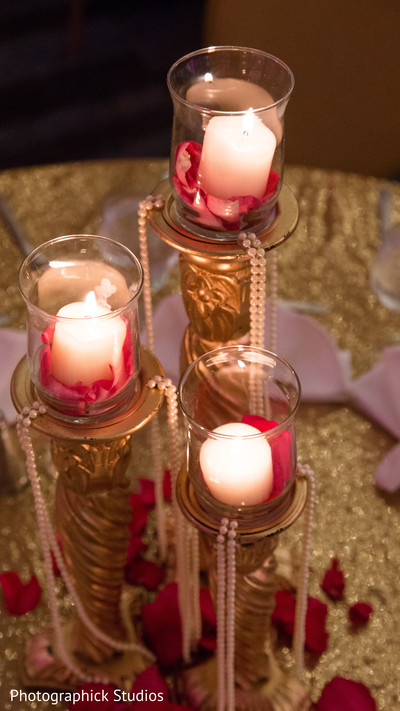 Golden candle sticks centerpiece decoration. in Alexandria, VA Indian Wedding by Photographick Studios