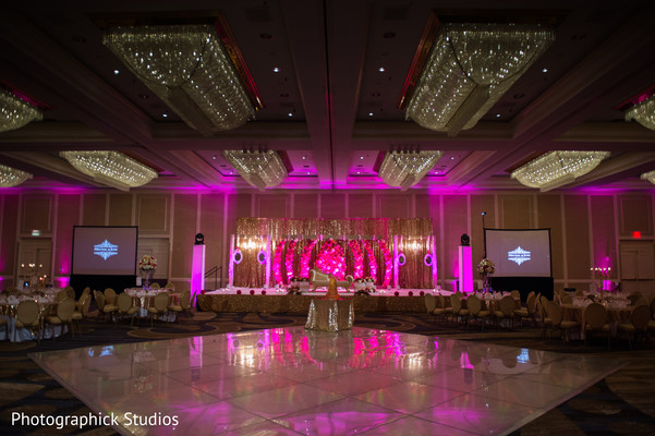 Indian wedding reception pink lights and decoration. in Alexandria, VA Indian Wedding by Photographick Studios