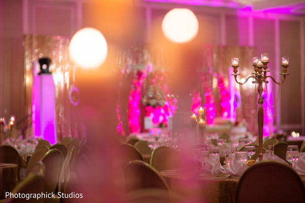 Indian wedding reception pink lighting in Alexandria, VA Indian Wedding by Photographick Studios
