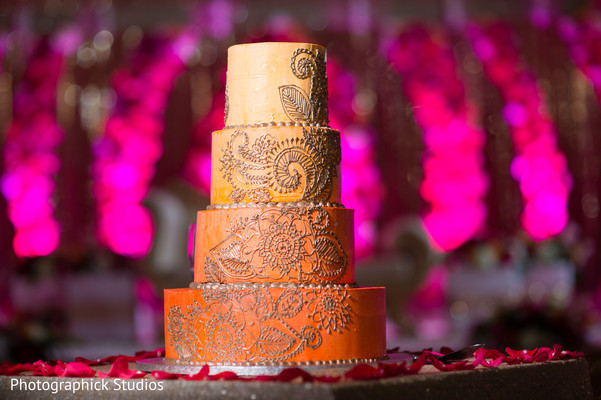 Beautiful photography of indian wedding cake. in Alexandria, VA Indian Wedding by Photographick Studios